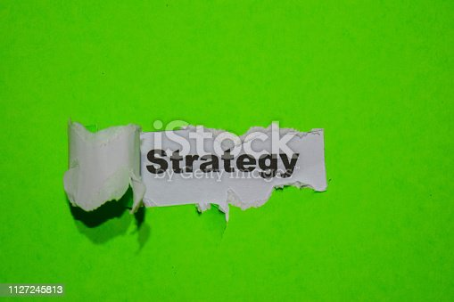 istock Strategy, business concept on green torn paper 1127245813