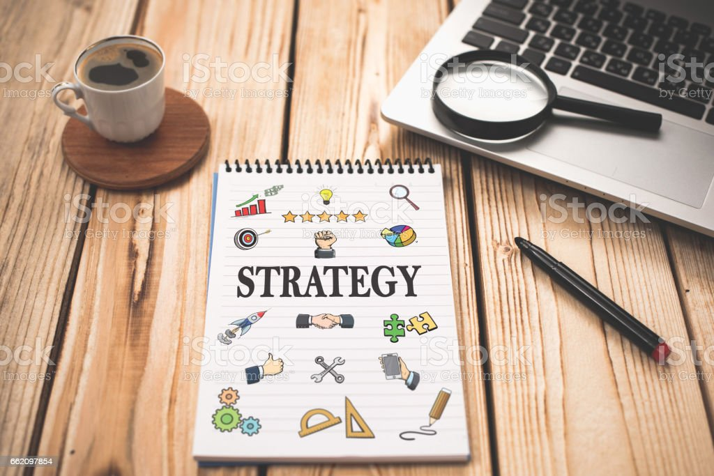Strategy Concept With Various Hand Drawn Doodle Icons On Paper royalty-free stock photo