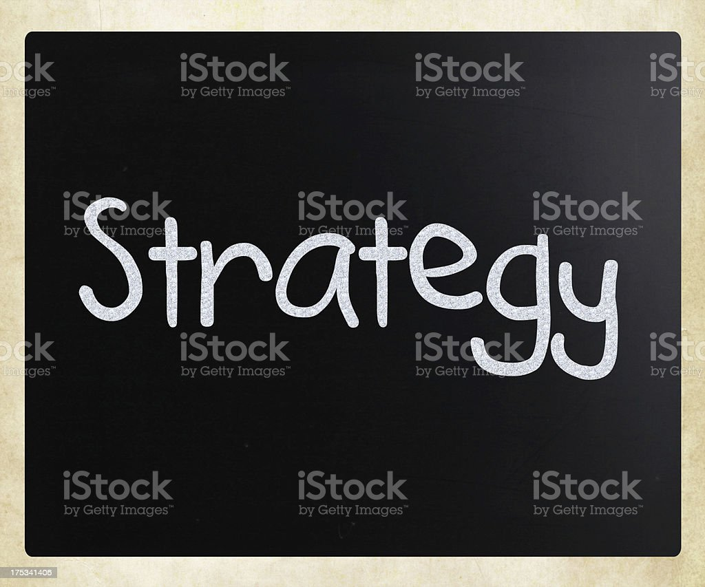 'Strategy' handwritten with white chalk on a blackboard royalty-free stock photo