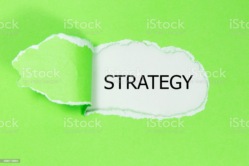 Strategy message written under torn paper. foto royalty-free