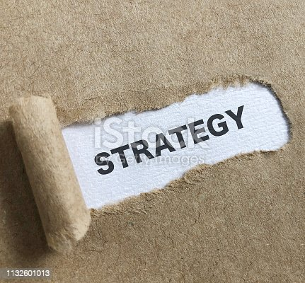 1140385944 istock photo Strategy text on paper. 1132601013