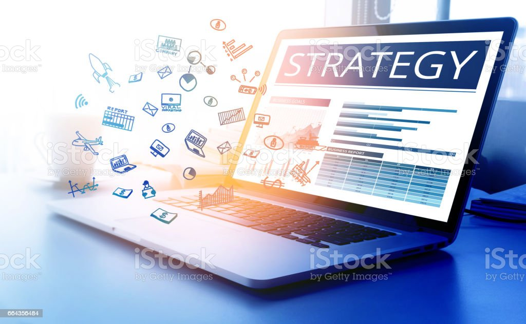 Strategy text with business icon on modern laptop screen stock photo