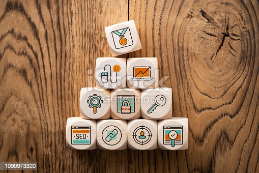 istock SEO strategy with components for successful marketing as icons on cubes 1090973320