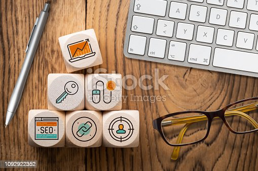 istock SEO strategy with components for successful marketing as icons on cubes 1092922352