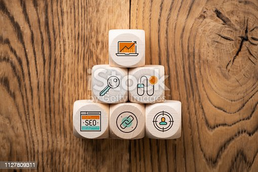 istock SEO strategy with components for successful marketing as icons on cubes 1127809311