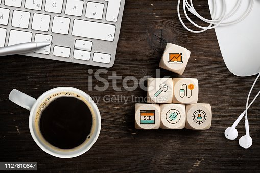 1132786150 istock photo SEO strategy with components for successful marketing as icons on cubes 1127810647