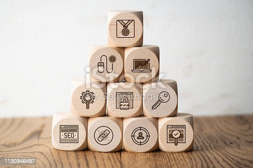 1132786150 istock photo SEO strategy with components for successful marketing as icons on cubes 1130946497