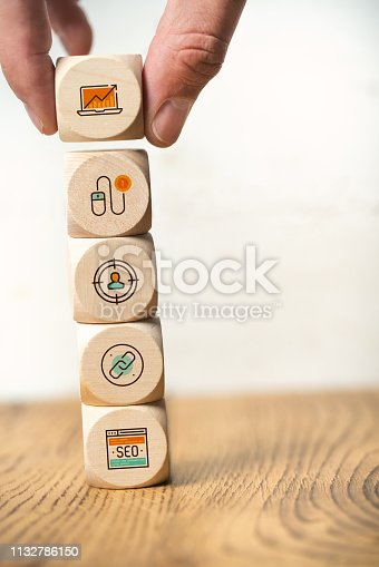 1132786150 istock photo SEO strategy with components for successful marketing as icons on cubes 1132786150