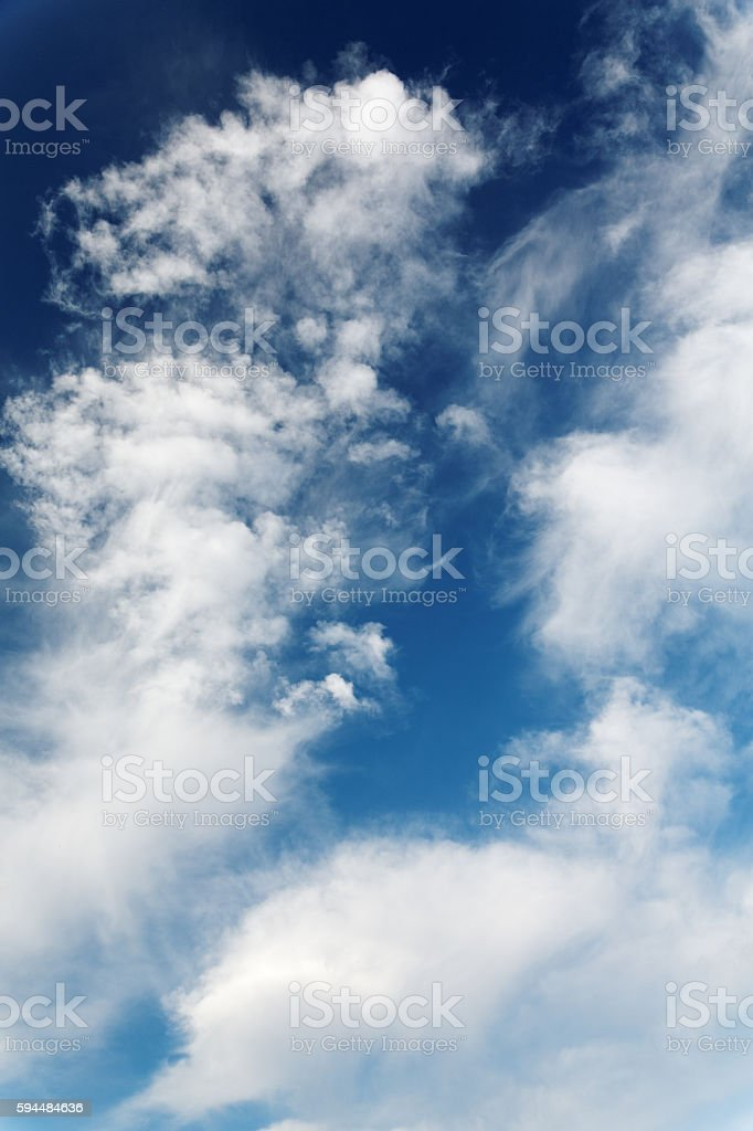 stratocumulus clouds and the dark blue sky stock photo