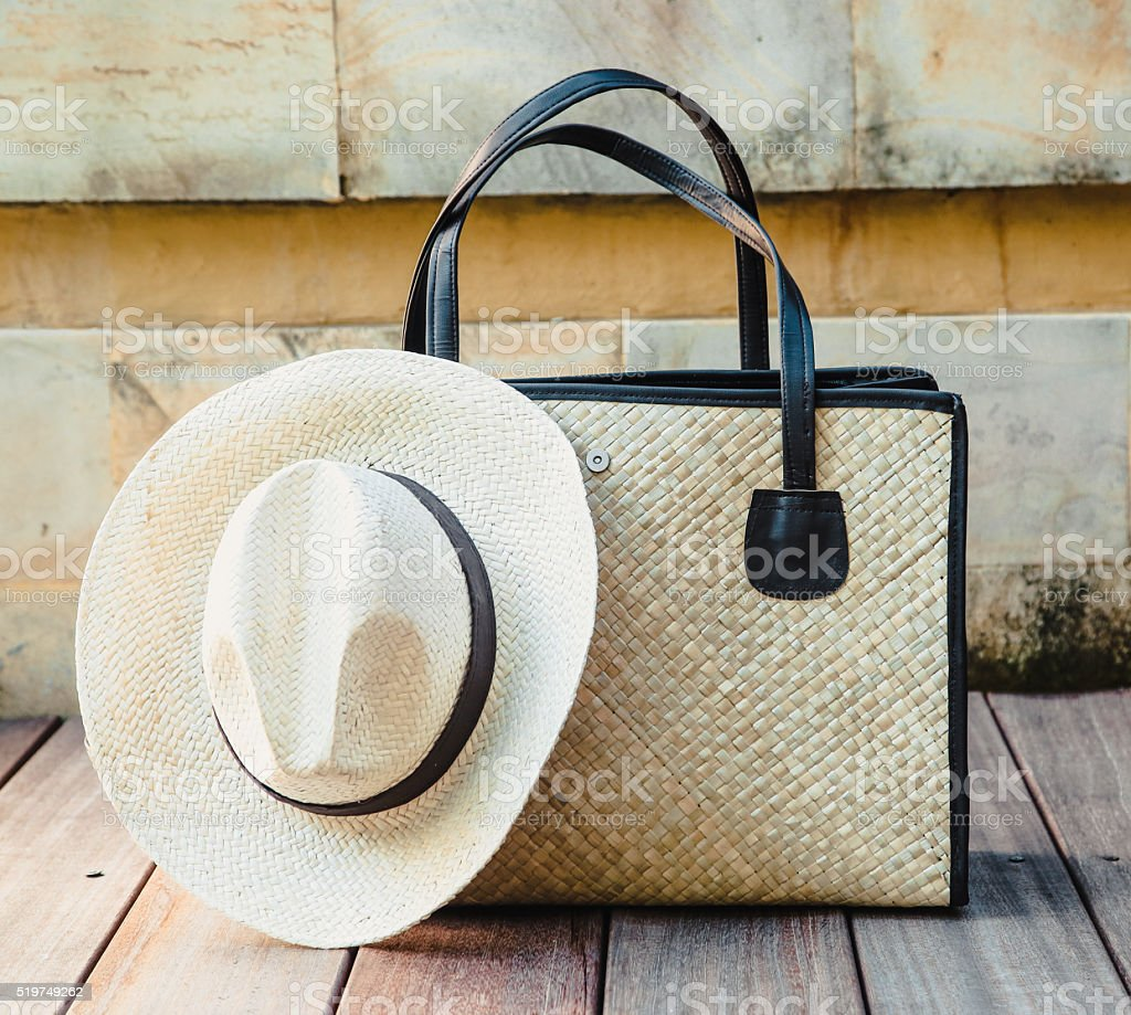 Straw bag and hat stock photo