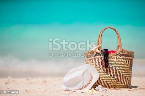 istock Straw bag, fist star, headphones, hat and sunglasses on white 637564454