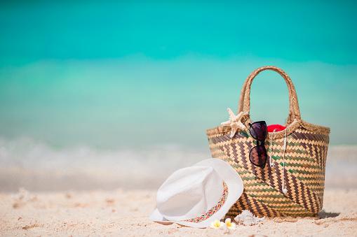istock Straw bag, fist star, headphones, hat and sunglasses on white 637564454