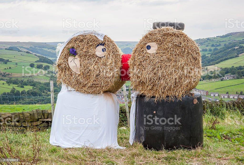 Straw bail wedding couple stock photo