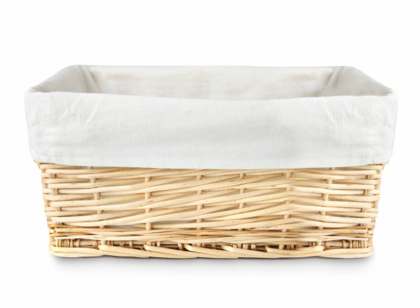 Straw basket isolated. Straw basket with linen isolated. wicker stock pictures, royalty-free photos & images