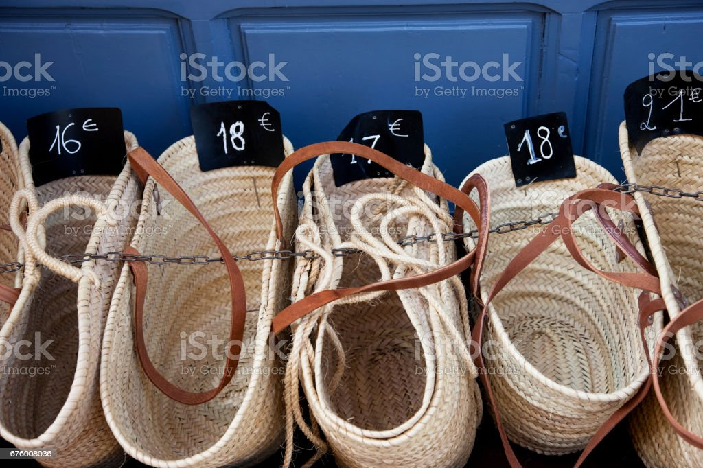 Straw baskets on sale at street market in Nice stock photo