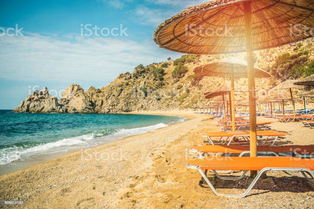 Straw beach umbrella with sea ocean beach stock photo