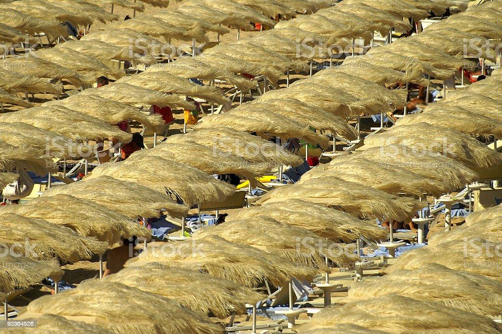 Straw beach umbrellas royalty-free stock photo