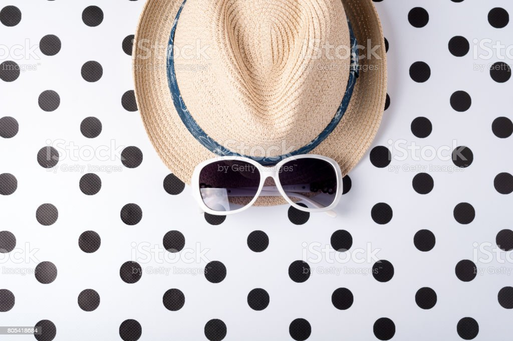 Straw beach woman\'s hat sun glasses top view on creative background....