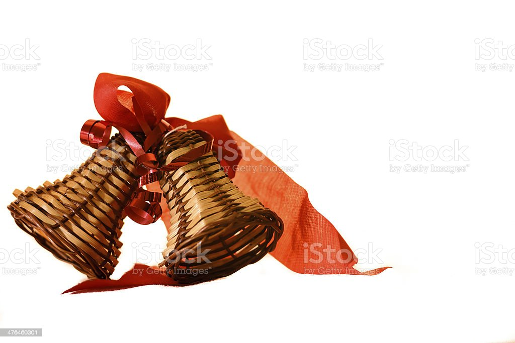 Straw bells with red ribbon. royalty-free stock photo