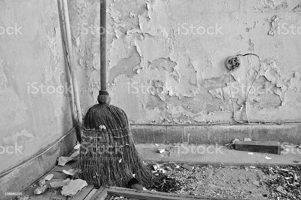 straw broom on dirty floor stock photo