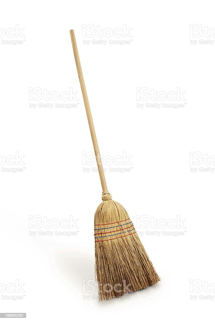 Straw broomstick against white background stock photo