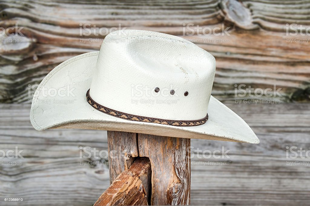 Straw Cowboy Hat Sitting On A Post stock photo