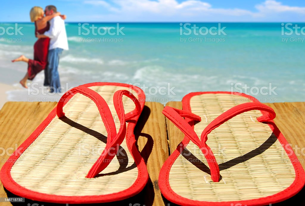 Straw Flip Flops and couple royalty-free stock photo
