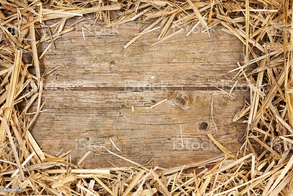 Straw frame on rustic wood stock photo