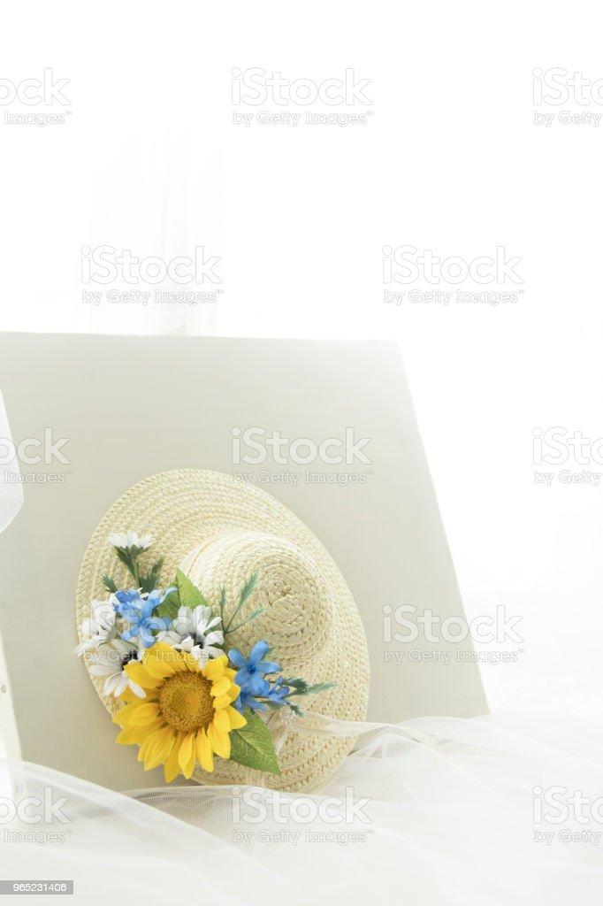 straw hat and Sunflower corsage zbiór zdjęć royalty-free
