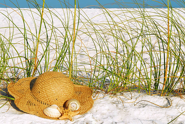 straw hat at the beach stock photo