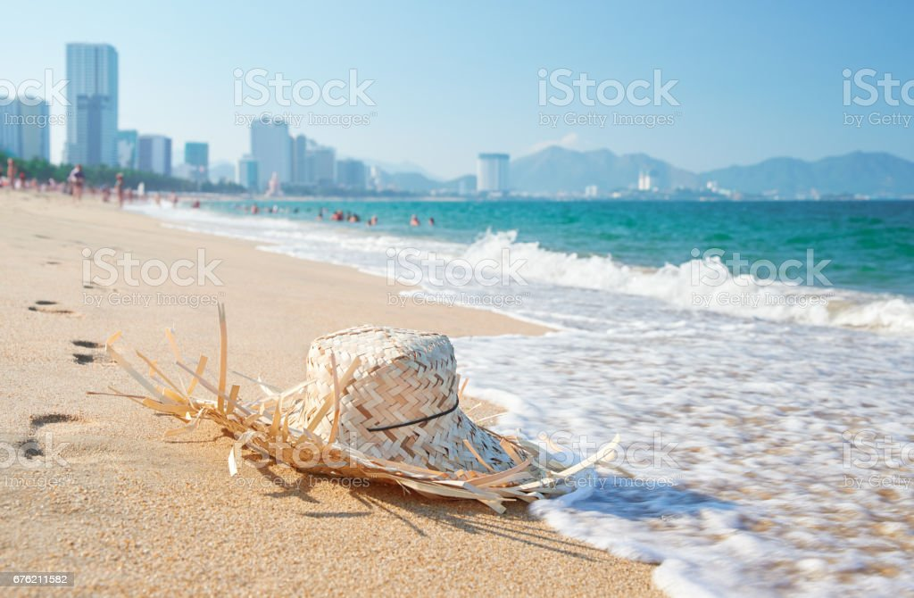 Straw hat lying on the tropical seaside stock photo
