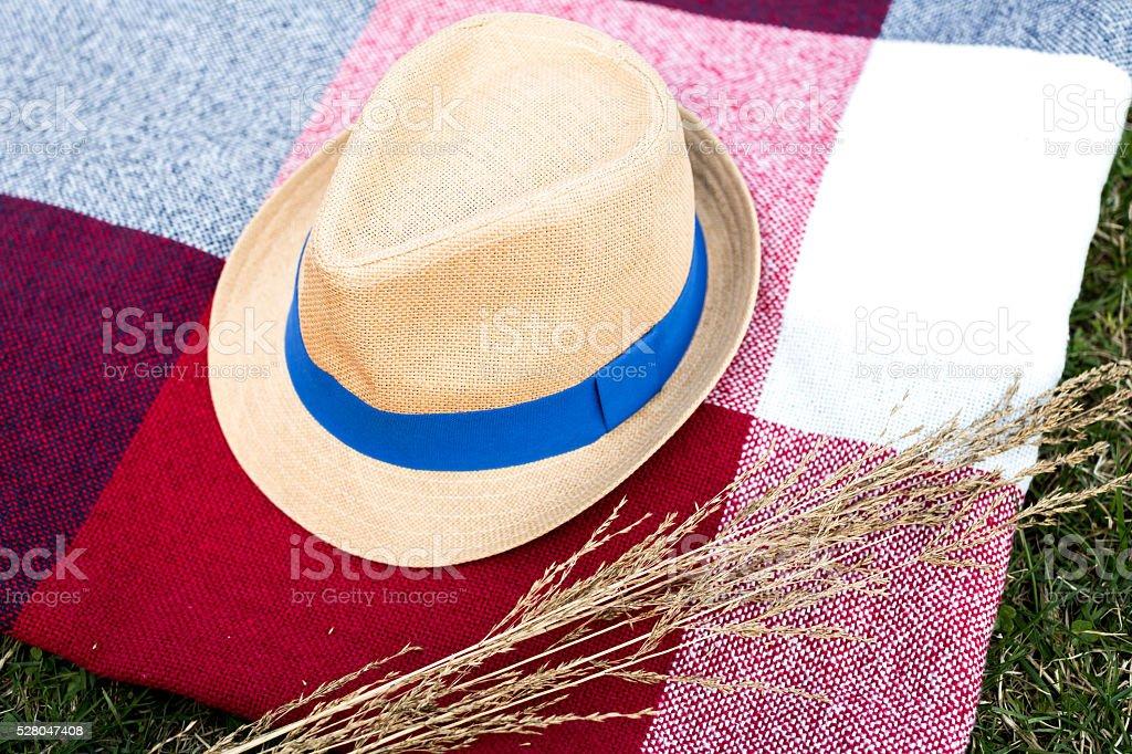 Straw hat on plaid stock photo