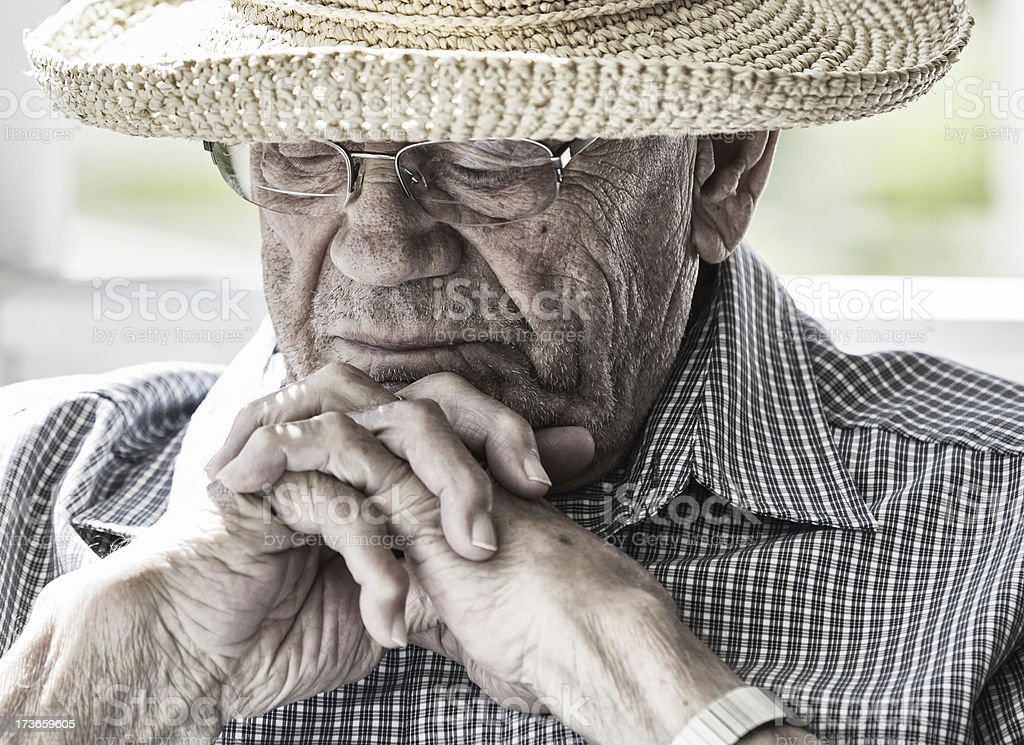 Straw Hat Senior Man Deep in Thought stock photo