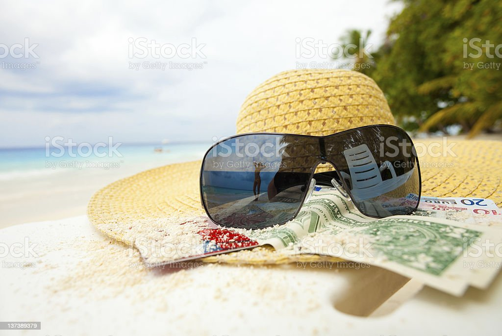 Straw hat, shades and money - all you that need stock photo