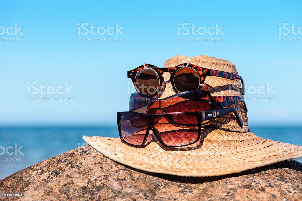 Straw hat with glasses stock photo