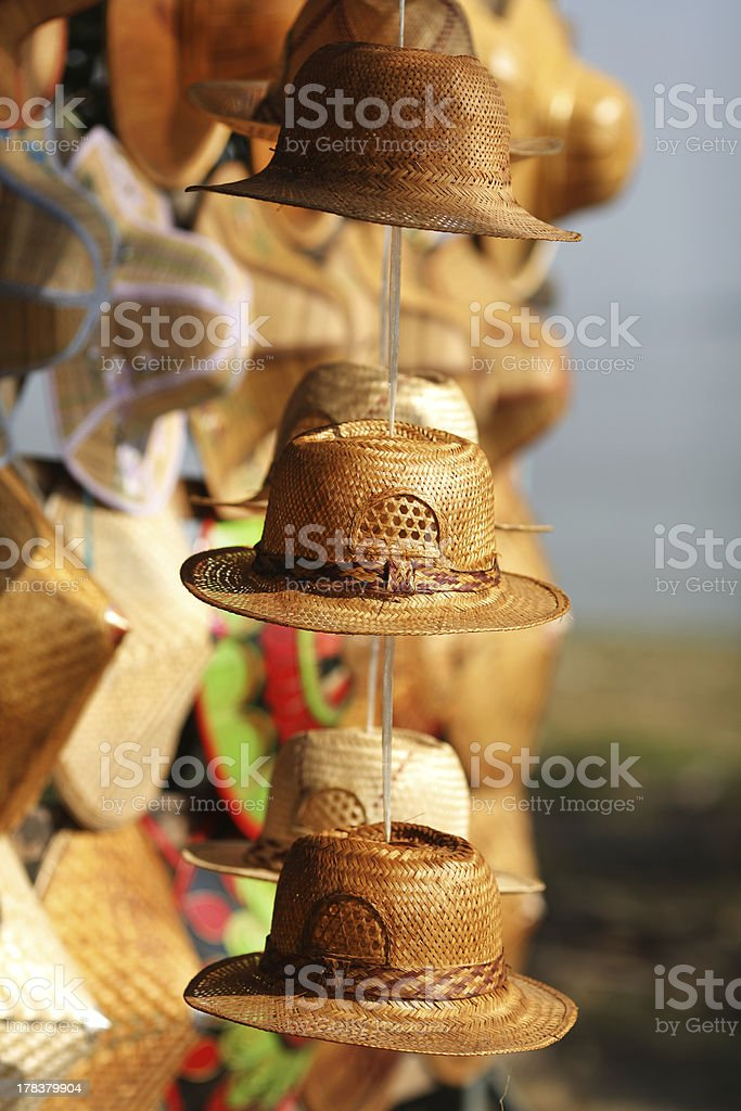 Straw hats selling on the craft and handmade market royalty-free stock photo