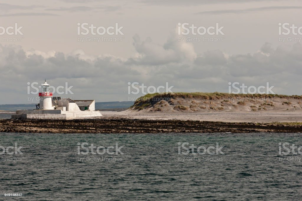Straw Island Lighthouse with Nesting Sea Birds, entrance to Killeany Bay, Inishmore stock photo