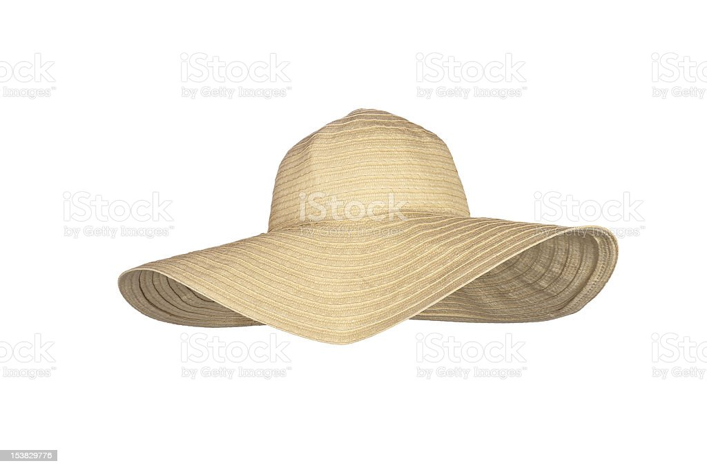 A straw large-rimmed beach hat on a white background A straw beach sun hat isolated on white Beige Stock Photo