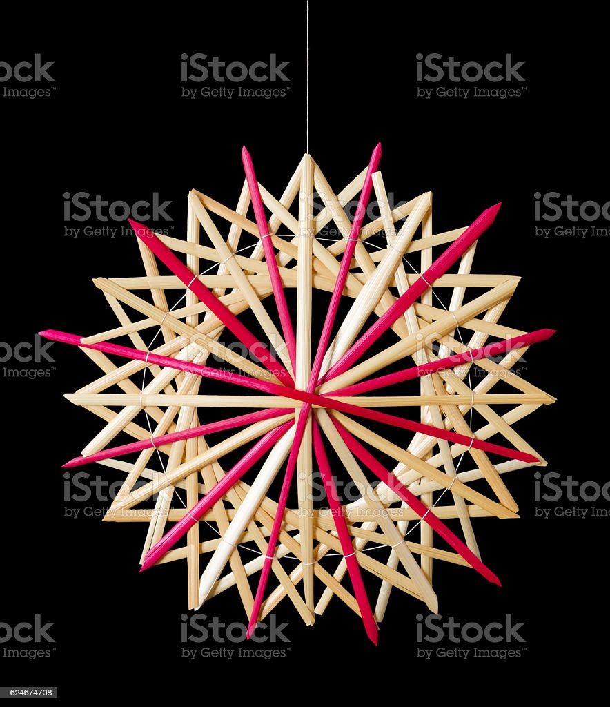Straw star Christmas decoration over black stock photo