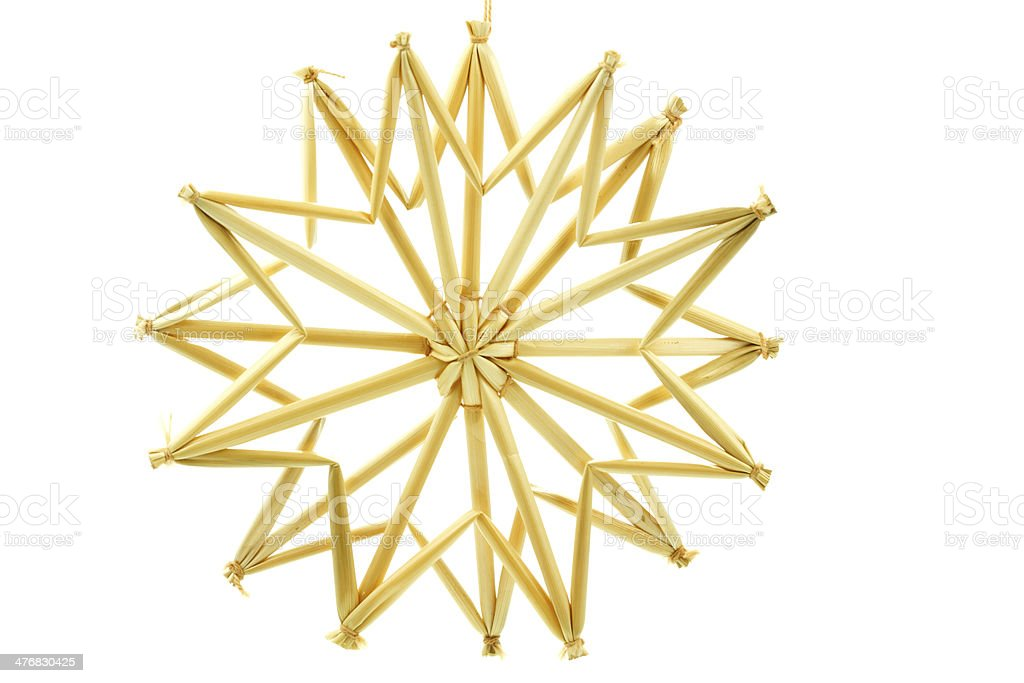 Straw star for a christmas tree on white background stock photo