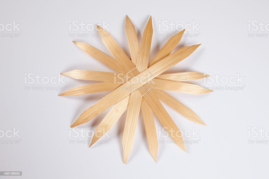 Straw star, white background, copy space stock photo