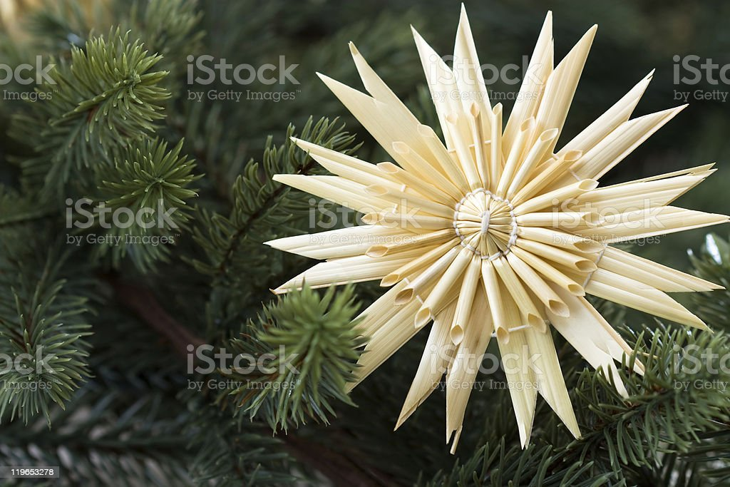 Straw star with fir bough stock photo
