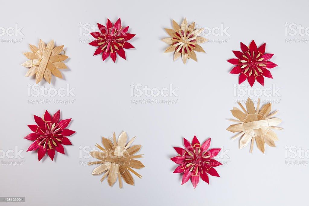 Straw stars, white background, copy space stock photo