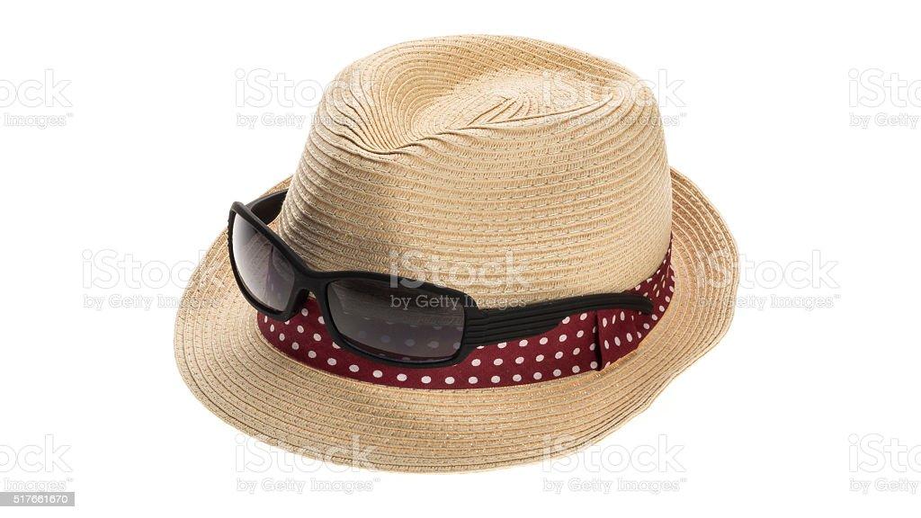 Straw sun hat and sunglasses stock photo
