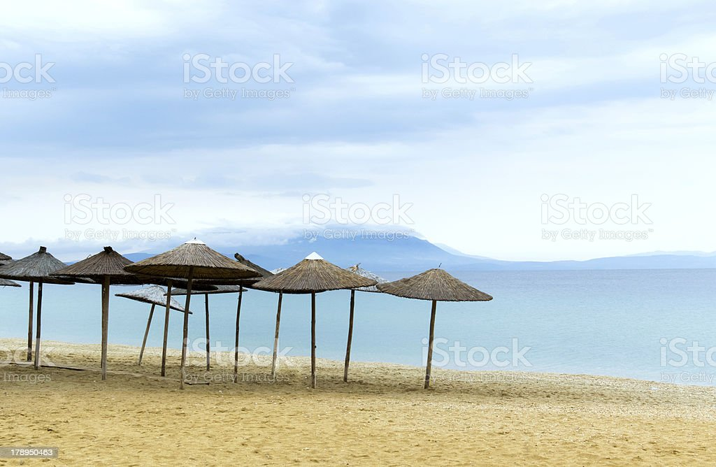 Straw Umbrella on the Beach royalty-free stock photo