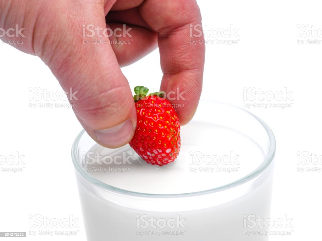 Strawberrie and a glass of milk royalty-free stock photo