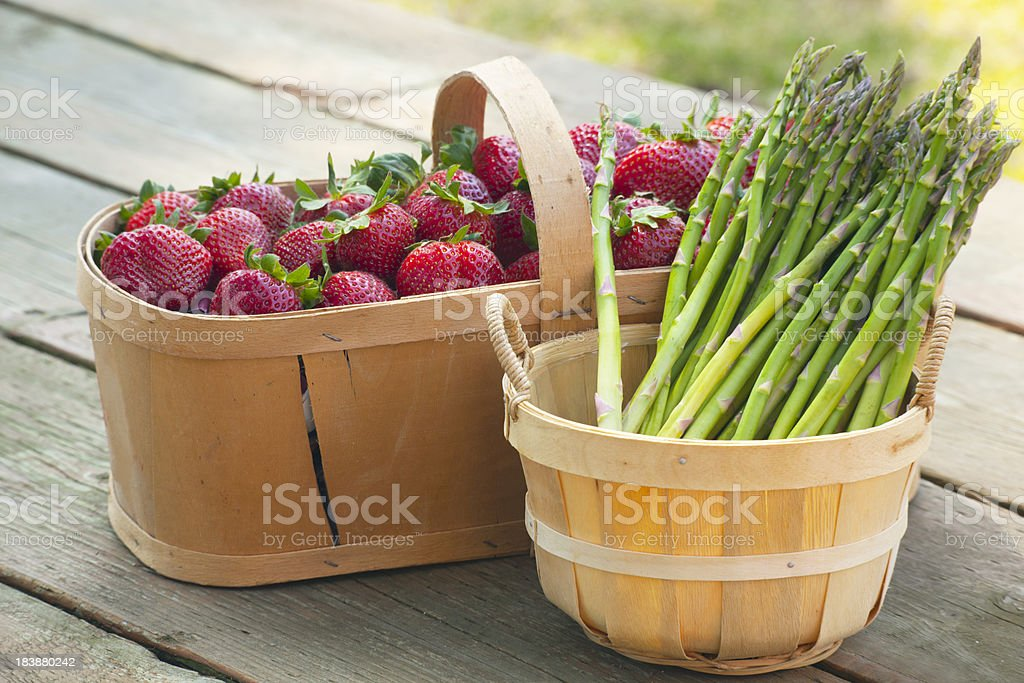 Strawberries and Asparagus in Baskets royalty-free stock photo