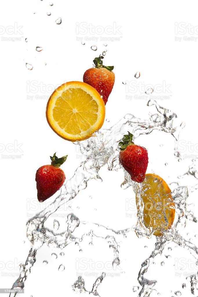 Strawberries and orange slices in a water splash royalty-free stock photo
