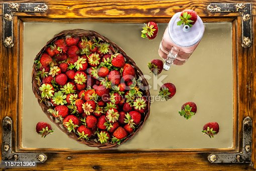 istock Strawberries and strawberry milk decorated on antique wooden frame 1157213960