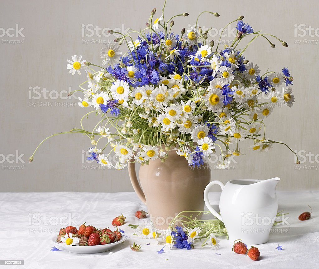 Strawberries and wild flowers royalty-free stock photo